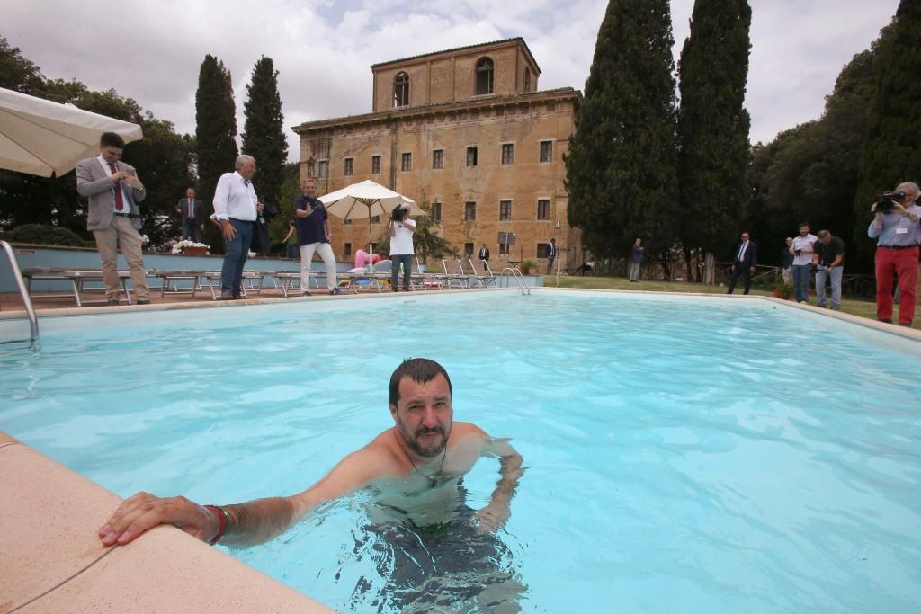 Interior Minister Matteo Salvini bathes in the swimming pool as he visits a farm confiscated in 2007 to the Italian mafia, in Suvignano, near Siena, c