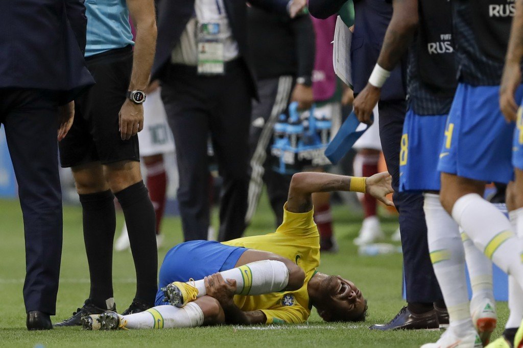 Brazil's Neymar lies on the ground during the round of 16 match between Brazil and Mexico at the 2018 soccer World Cup in the Samara Arena, in Samara,