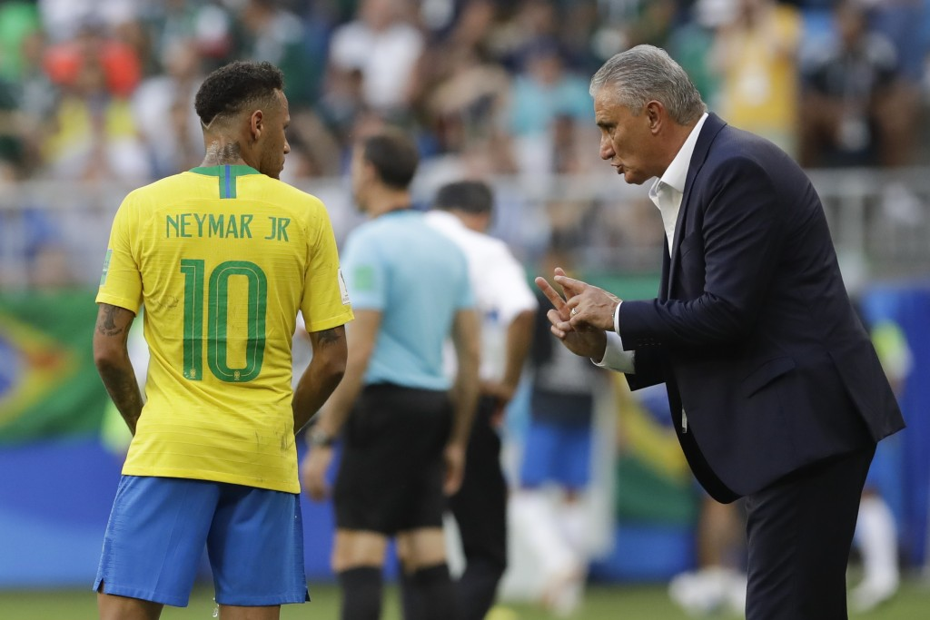 Brazil head coach Tite, right, talks to Brazil's Neymar, left, during the round of 16 match between Brazil and Mexico at the 2018 soccer World Cup in ...