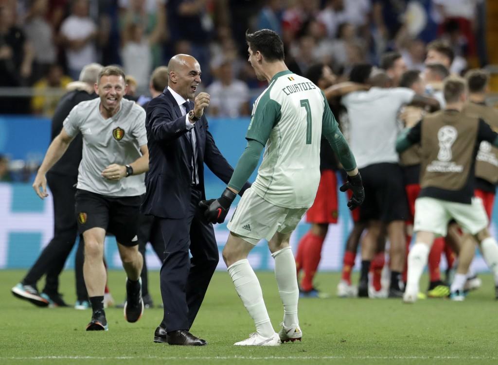 Belgium coach Roberto Martinez celebrates with Belgium goalkeeper Thibaut Courtois after winning the round of 16 match between Belgium and Japan at th