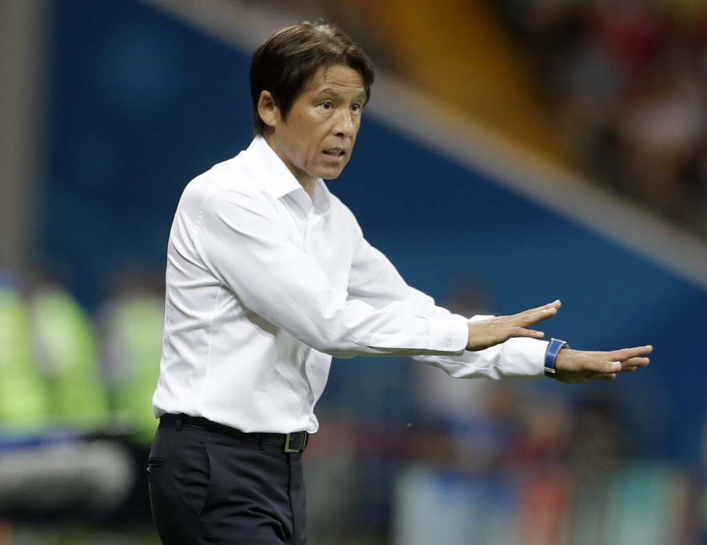 Japan's head coach Akira Nishino reacts in his coaching zone during the round of 16 match between Belgium and Japan at the 2018 soccer World Cup in th