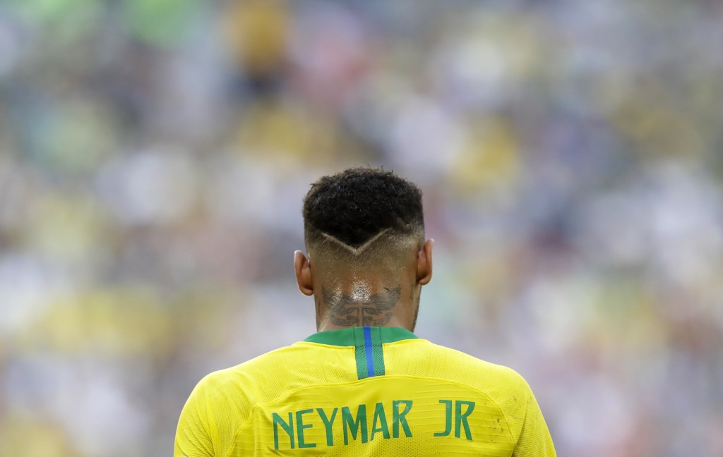 Brazil's Neymar walks on the pitch during the round of 16 match between Brazil and Mexico at the 2018 soccer World Cup in the Samara Arena, in Samara,