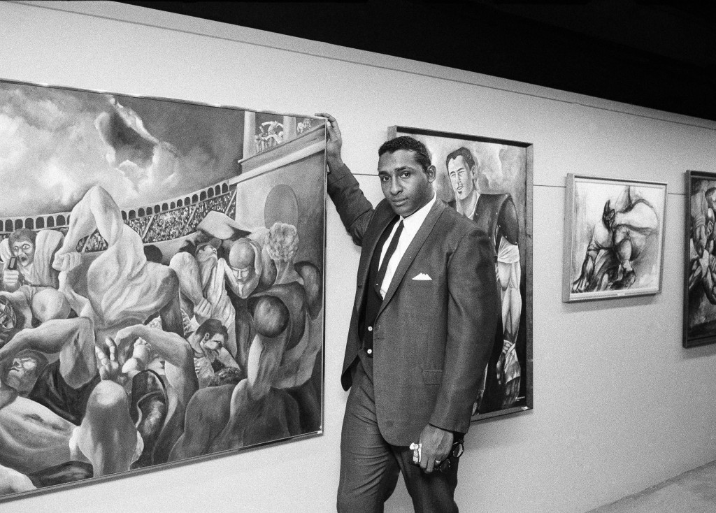 FILE - This Nov. 15, 1966, file photo shows Ernie Barnes, former offensive lineman for both the American and National Football leagues, standing along...
