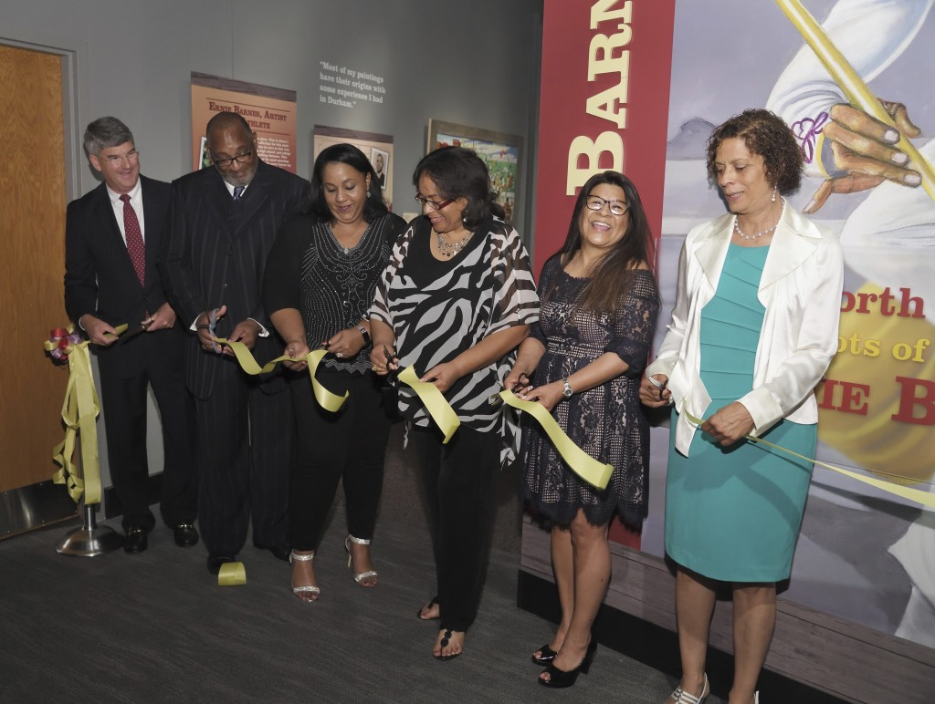 This June 29, 2018, photo made available by the North Carolina Museum of History shows family members of the late Ernie Barnes at a ribbon cutting cer...