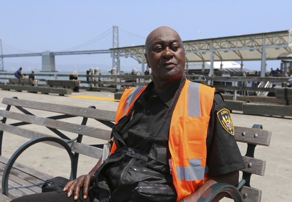 """Louisiana native Henry Belton, 71, takes a break on a bench at the San Francisco ferry landing Tuesday, July 3, 2018. """"It's part of being proud of Ame..."""