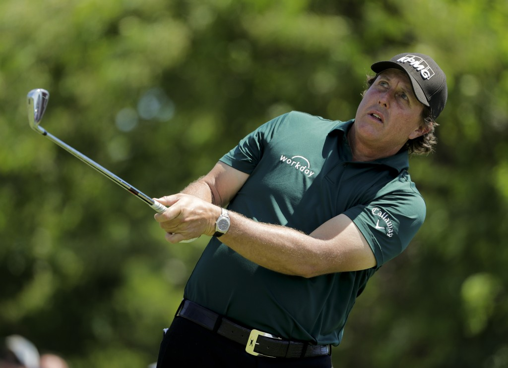 FILE - In this June 16, 2018 file photo Phil Mickelson plays a shot on the 11th tee during the third round of the U.S. Open Golf Championship in South