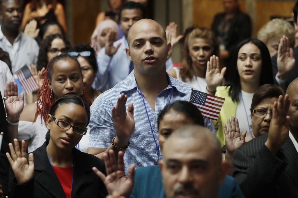 New citizens participate in a naturalization ceremony, Tuesday, July 3, 2018, at the New York Public Library. Two hundred people from 50 countries gai...
