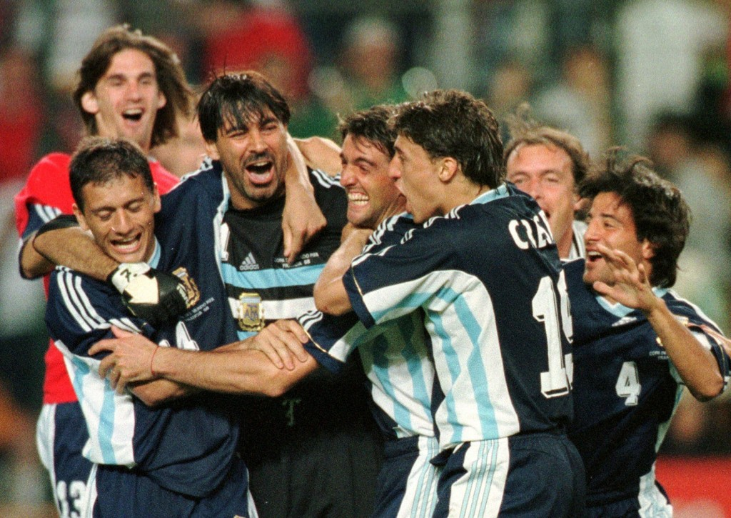 FILE - In this Tuesday, June 30, 1998 file photo, Argentine goalkeeper Carlos Roa is embraced by teammates after saving a penalty from England's David...