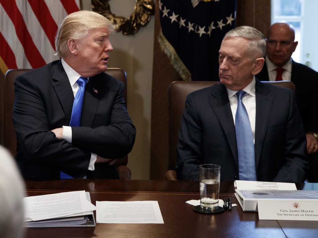 FILE - In this Dec. 20, 2017, file photo, Secretary of Defense Jim Mattis listens as President Donald Trump speaks during a cabinet meeting at the Whi...