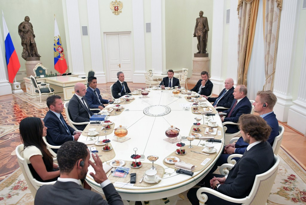 Russian President Vladimir Putin, third right, attends a meeting with world soccer legends in the Kremlin in Moscow, Russia, Friday, July 6, 2018. (Al