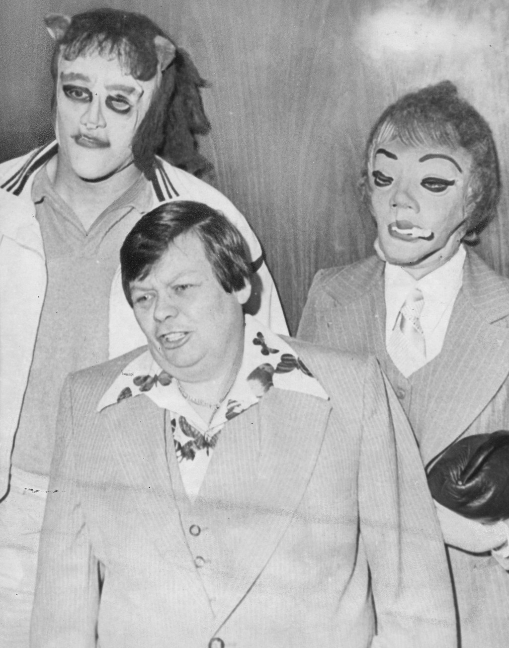 """This 1979 photo shows transgender man Dante """"Tex"""" Gill, flanked by masked Frank Cocchiara, left, and Donna Potts while leaving the Public Safety Build"""