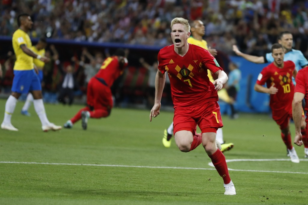 Belgium's Kevin De Bruyne, center, celebrates after scoring his side's second goal during the quarterfinal match between Brazil and Belgium at the 201