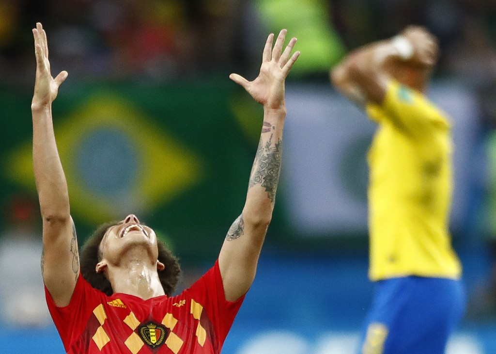 Belgium's Axel Witsel, centre celebrates after the final whistle as Belgium defeat Brazil in their quarterfinal match between Brazil and Belgium at th