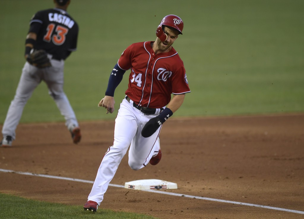 Washington Nationals' Bryce Harper (34) rounds third base and head to home plate to score on a double by teammate Mark Reynolds during the fourth inni