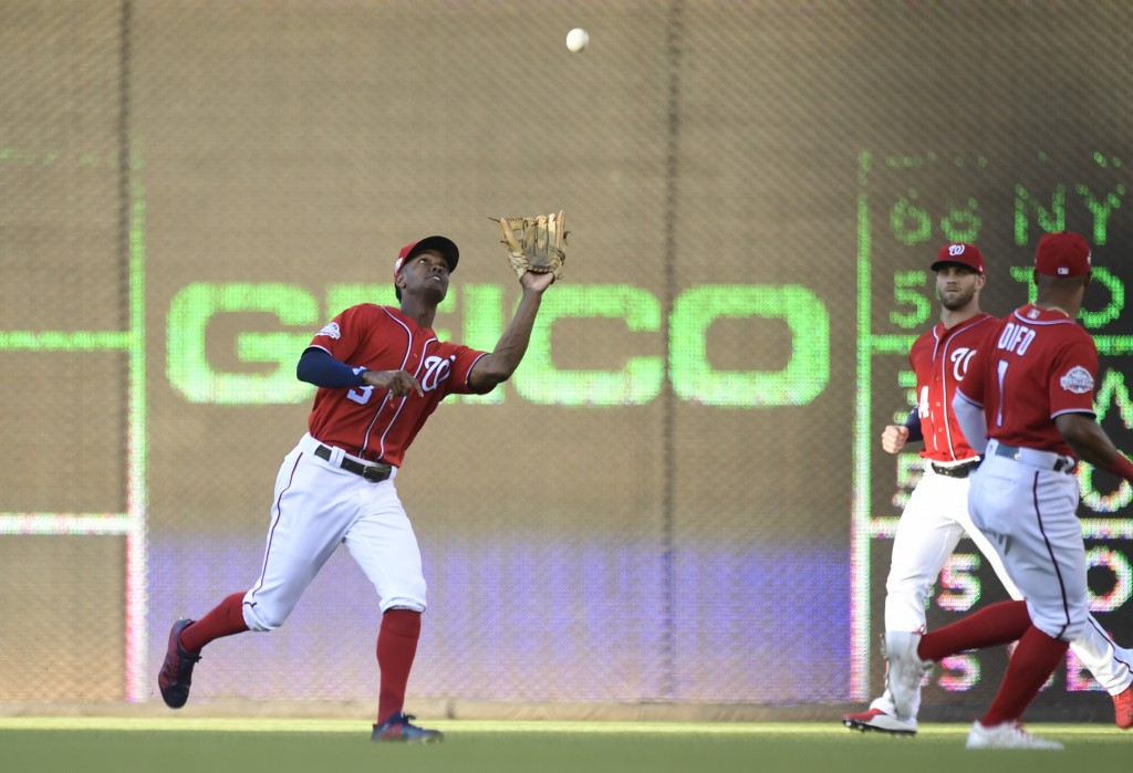 Washington Nationals center fielder Michael Taylor (3) catches a fly ball hit by Miami Marlins' Starlin Castro during the first inning of a baseball g