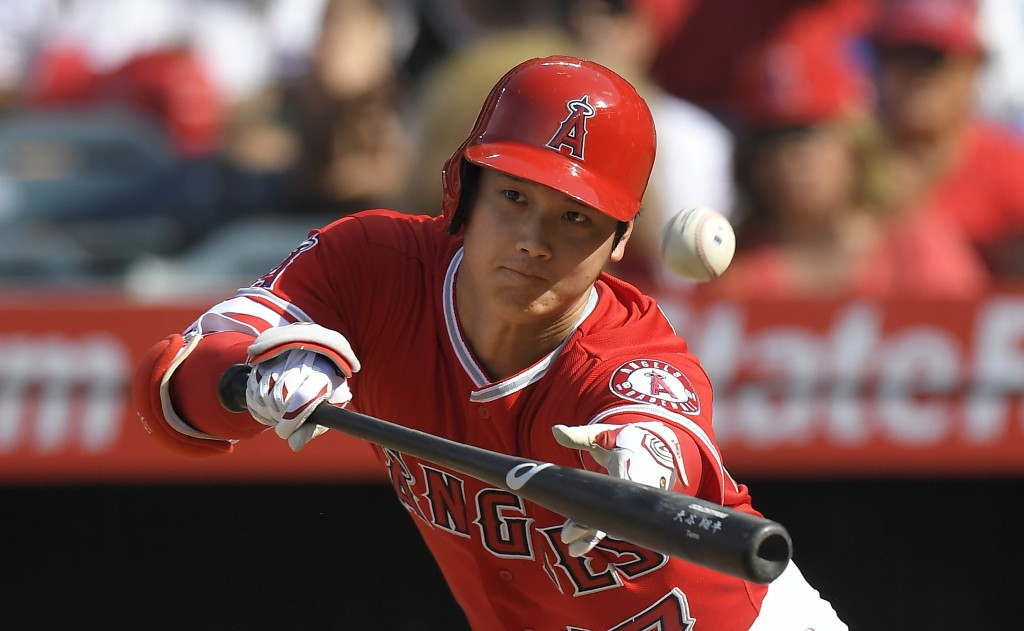 Los Angeles Angels' Shohei Ohtani, of Japan, bunts foul during the second inning of a baseball game against the Los Angeles Dodgers, Saturday, July 7,