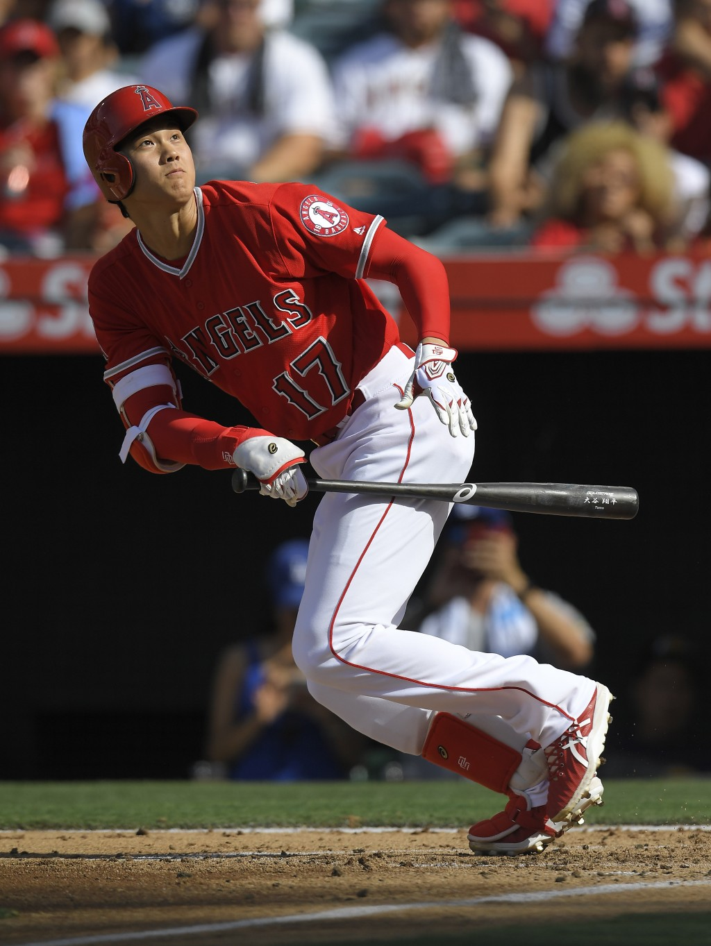 Los Angeles Angels' Shohei Ohtani, of Japan, runs to first as he bunts foul during the second inning of a baseball game against the Los Angeles Dodger