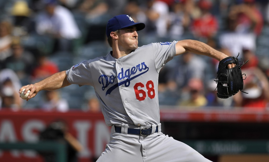 Los Angeles Dodgers starting pitcher Ross Stripling throws to the plate during the first inning of a baseball game against the Los Angeles Angels, Sat