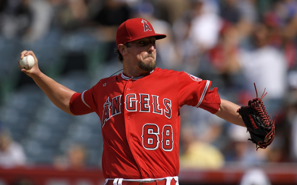 Los Angeles Angels starting pitcher Deck McGuire throws to the plate during the first inning of a baseball game against the Los Angeles Dodgers, Satur