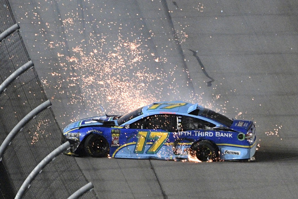 Ricky Stenhouse Jr. spins along the front stretch after blowing a rear tire during the NASCAR Cup Series auto race at Daytona International Speedway,