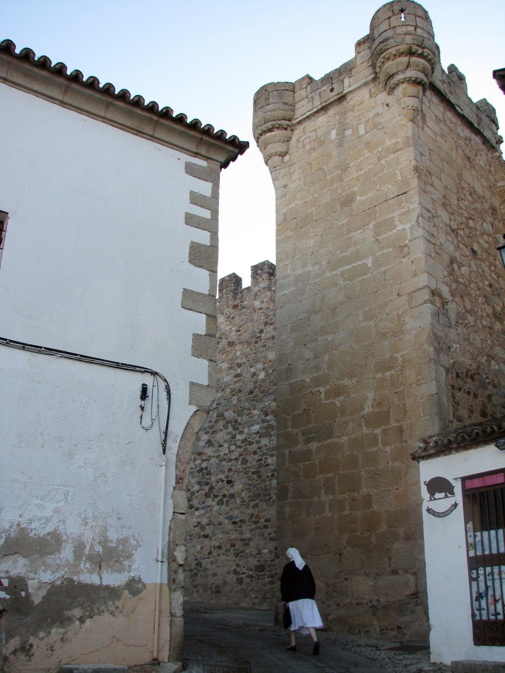This Oct. 27, 2017 photo shows a nun walking into the walled monumental center of Caceres, one of the most monument-filled, tourist-empty cities in Sp...