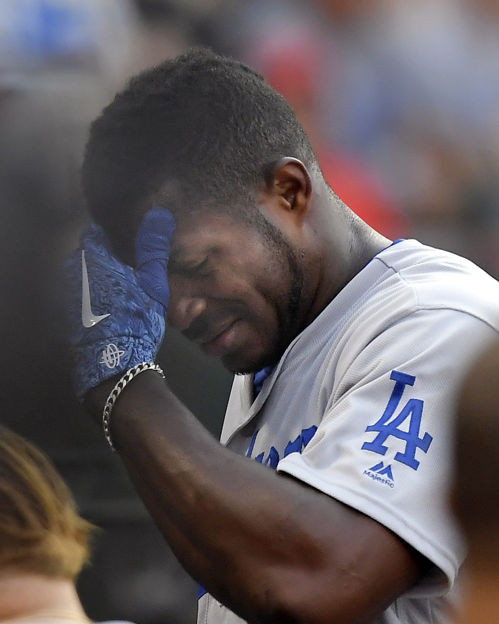 Los Angeles Dodgers' Yasiel Puig leaves the field after injuring himself while batting during the fifth inning of a baseball game against the Los Ange