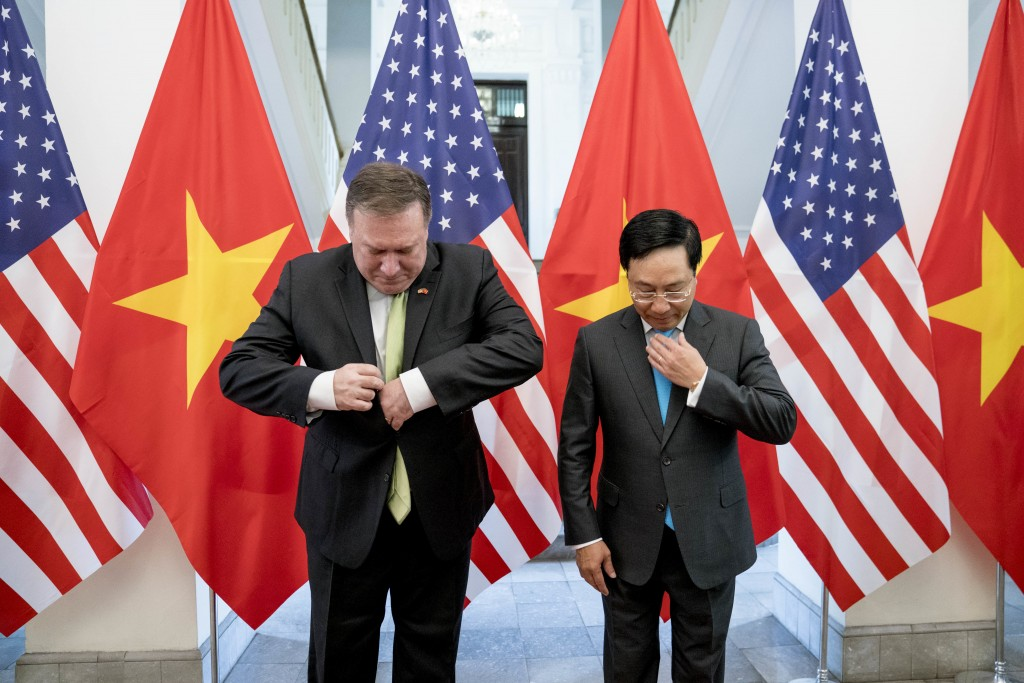 In this Monday, July 9, 2018, file photo, U.S. Secretary of State Mike Pompeo, left, and Vietnamese Deputy Prime Minister and Foreign Minister Pham Bi