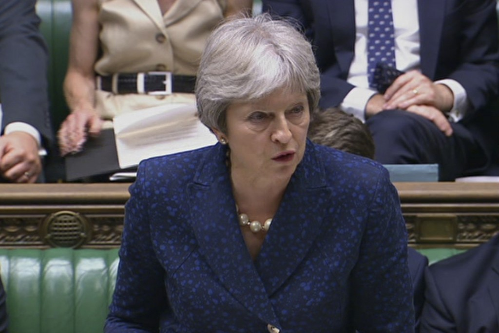 In this image from TV, Britain's Prime Minister Theresa May gives statement in the parliament Monday July 9, 2018. British Foreign Secretary Boris Joh