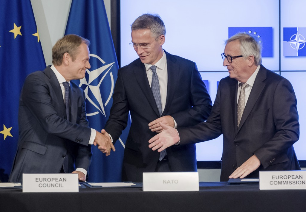 European Council President Donald Tusk, left, European Commission President Jean-Claude Juncker, right, and NATO Secretary General Jens Stoltenberg sh