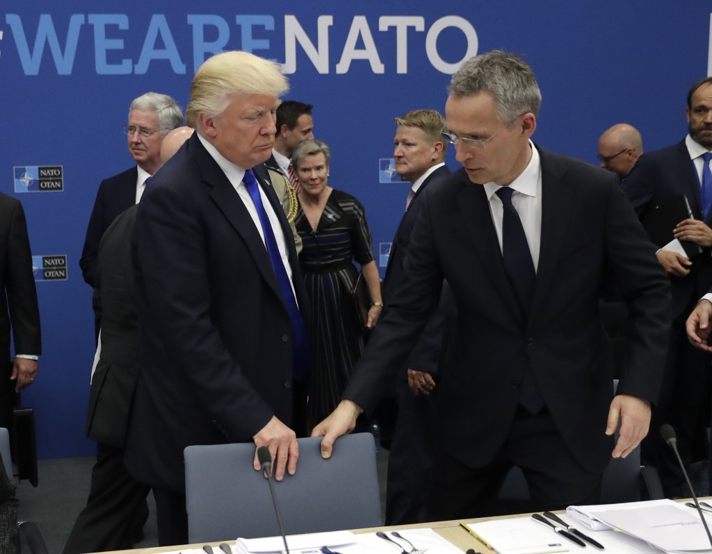 FILE - In this Thursday, May 25, 2017 file photo, U.S. President Donald Trump, left, and NATO Secretary General Jens Stoltenberg take a seat during a