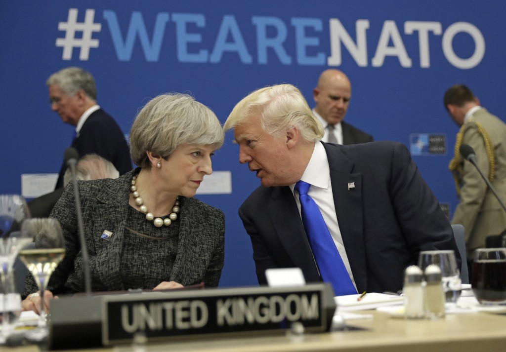 FILE -In this Thursday, May 25, 2017 file photo, British Prime Minister Theresa May, left, speaks to U.S. President Donald Trump during a NATO summit