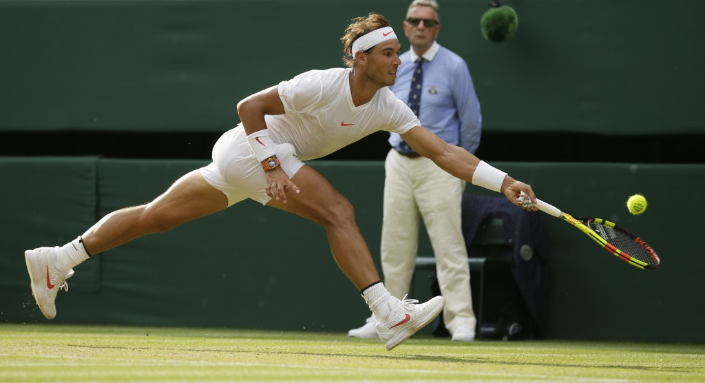 Rafael Nadal of Spain returns the ball to Czech Republic's Jiri Vesely during their men's singles match, on day seven of the Wimbledon Tennis Champion...