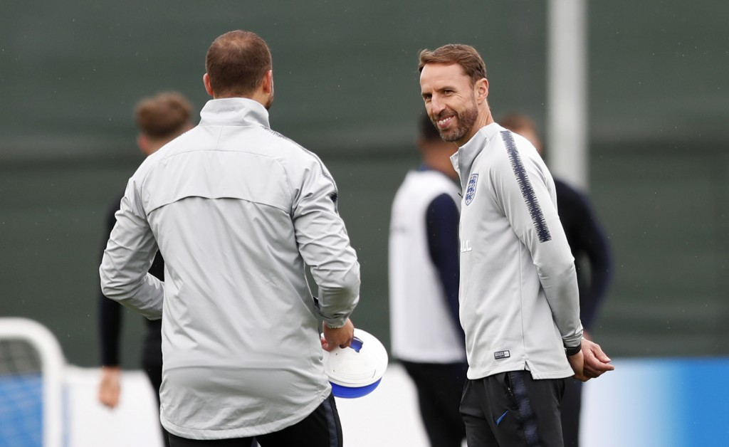 England head coach Gareth Southgate watches his players take part in a training session for the England team at the 2018 soccer World Cup, in the Spar...