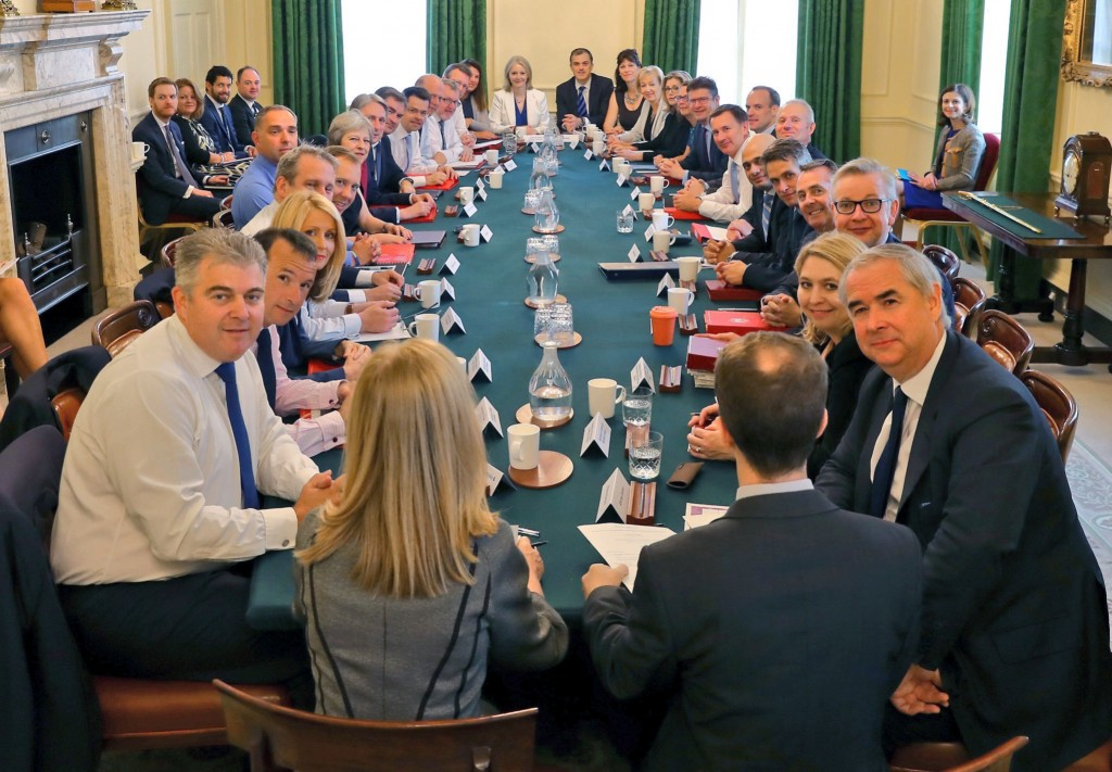 This is a handout photo provided by Downing Street showing a Cabinet meeting, in London, Tuesday, July 10, 2018.  British Prime Minister Theresa May h