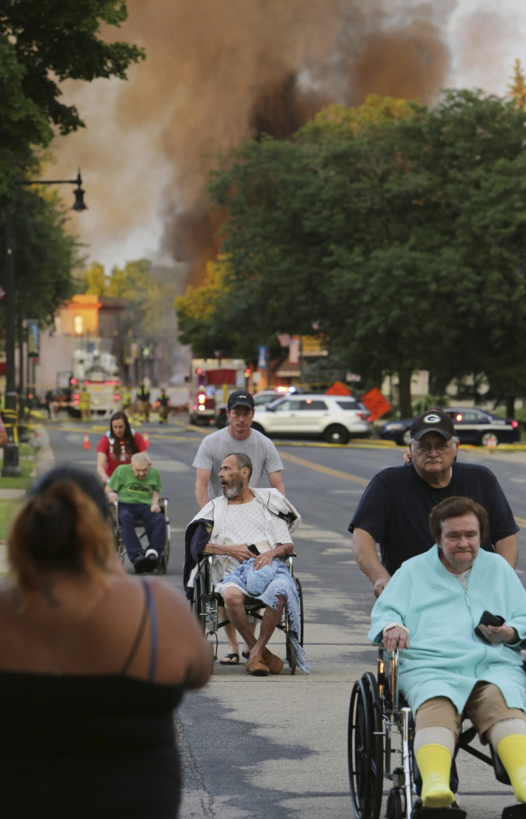 Residents are relocated from a nearby home after an explosion in downtown Sun Prairie, Wis., Tuesday, July 10, 2018. The explosion rocked the downtown