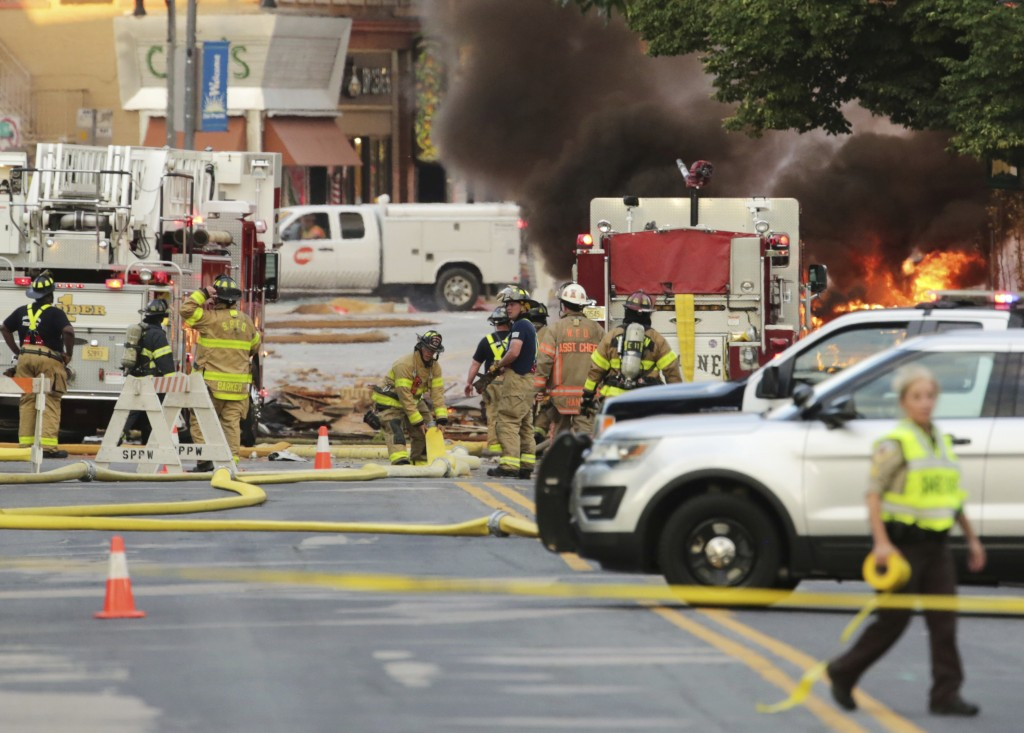 Authorities work the scene of an explosion in downtown Sun Prairie, Wis., Tuesday, July 10, 2018. The explosion rocked the downtown area of Sun Prairi