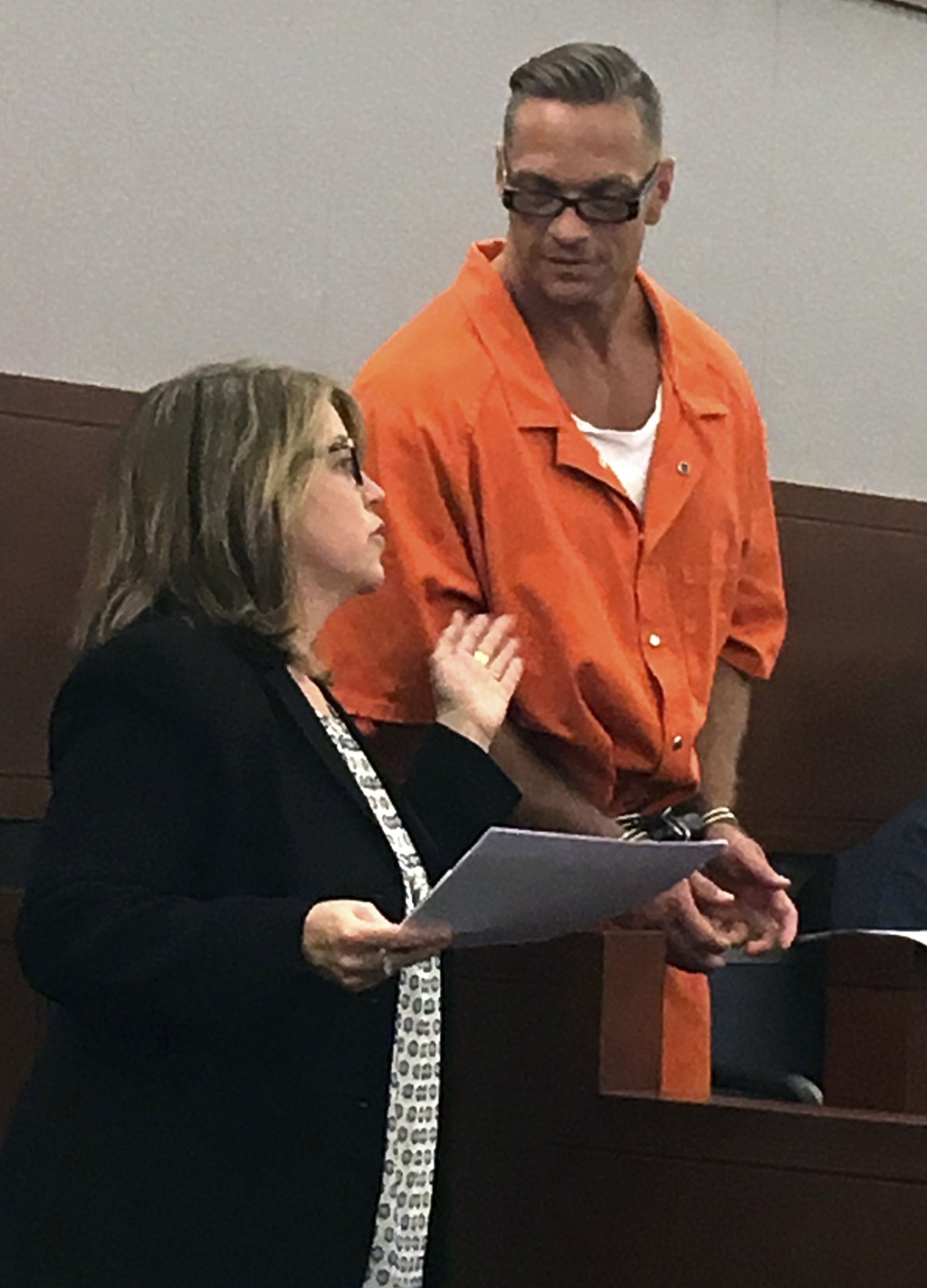 FILE - In this Aug. 17, 2017, file photo, Nevada death row inmate Scott Dozier, right, confers with Lori Teicher, a federal public defender involved i