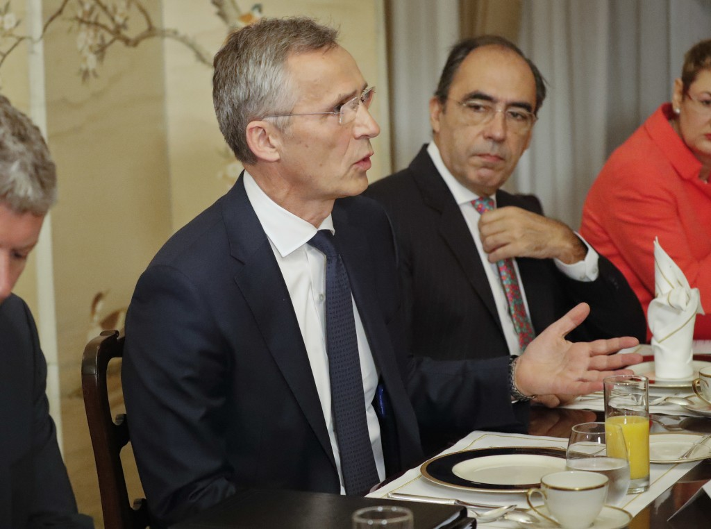 NATO Secretary General Jens Stoltenberg, gestures while speaking to U.S. President Donald Trump during their bilateral breakfast, Wednesday, July 11,