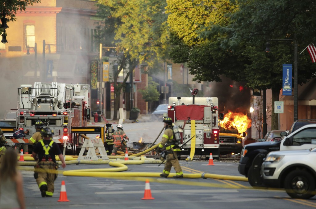 Firefighters work the scene of an explosion in downtown Sun Prairie, Wis., Tuesday, July 10, 2018. The explosion rocked the downtown area of Sun Prair