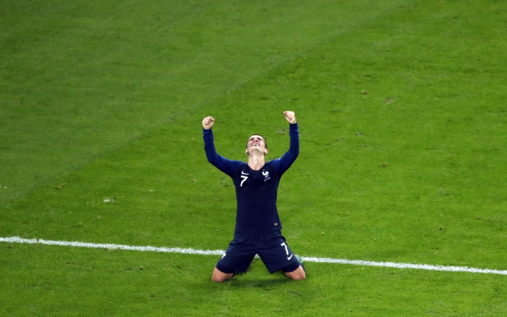 France's Antoine Griezmann celebrates at the end of the semifinal match between France and Belgium at the 2018 soccer World Cup in the St. Petersburg