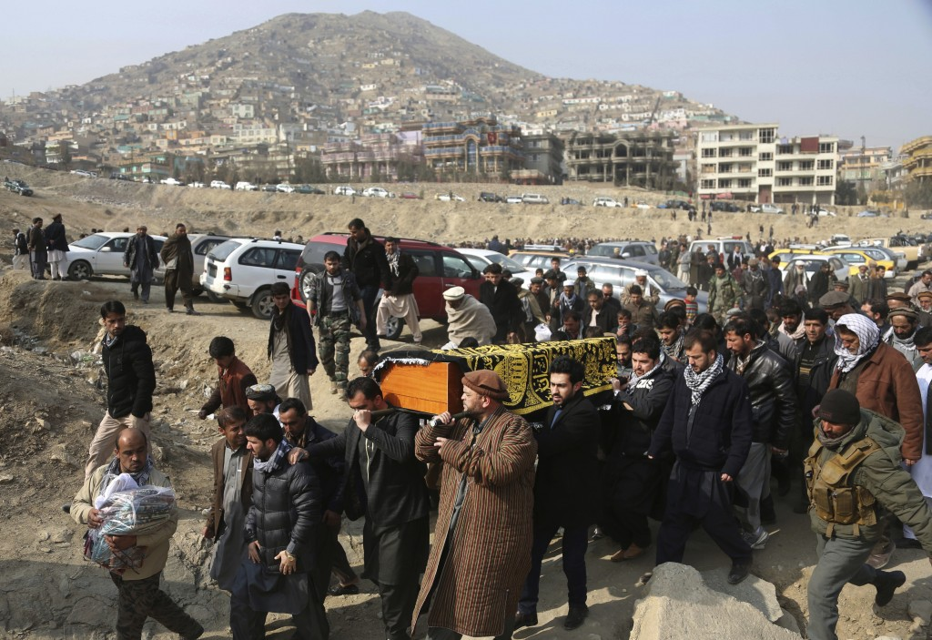 FILE - In this Jan. 28, 2018 file photo, mourners carry the coffin of a relative who died in a deadly attack a day earlier that killed over 100 people...