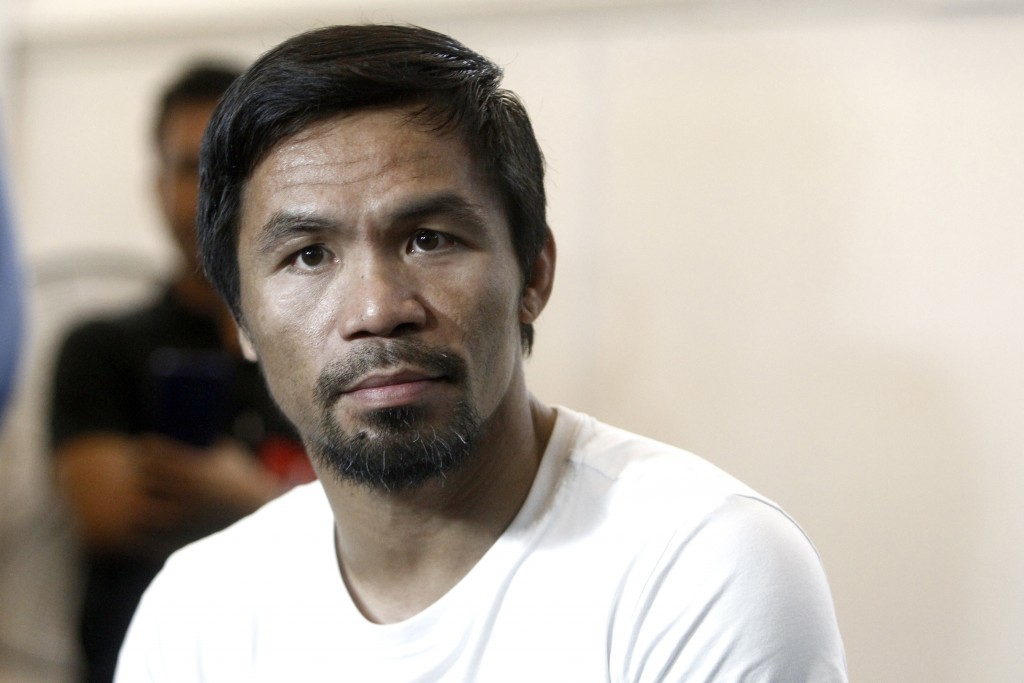 Philippine senator and boxing champion Manny Pacquiao trains at a press preview in Kuala Lumpur, Malaysia, Wednesday, July 11, 2018. Pacquiao is sched
