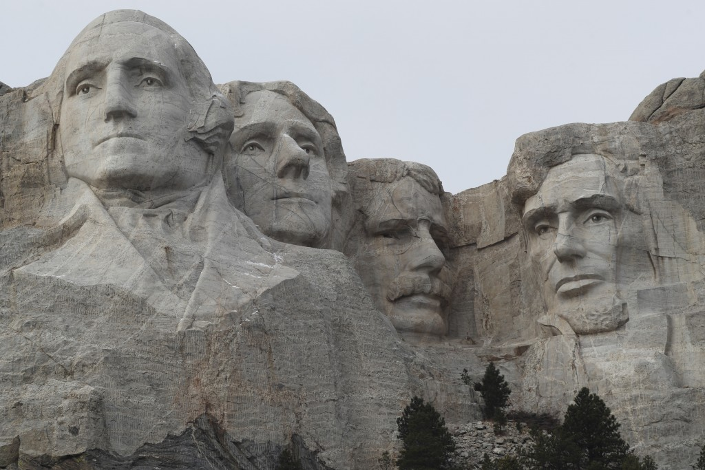 FILE - In this Dec. 9, 2016, file photo, the faces of the presidents that make up the Mount Rushmore monument are shown near Keystone, S.D. The PBS ho...