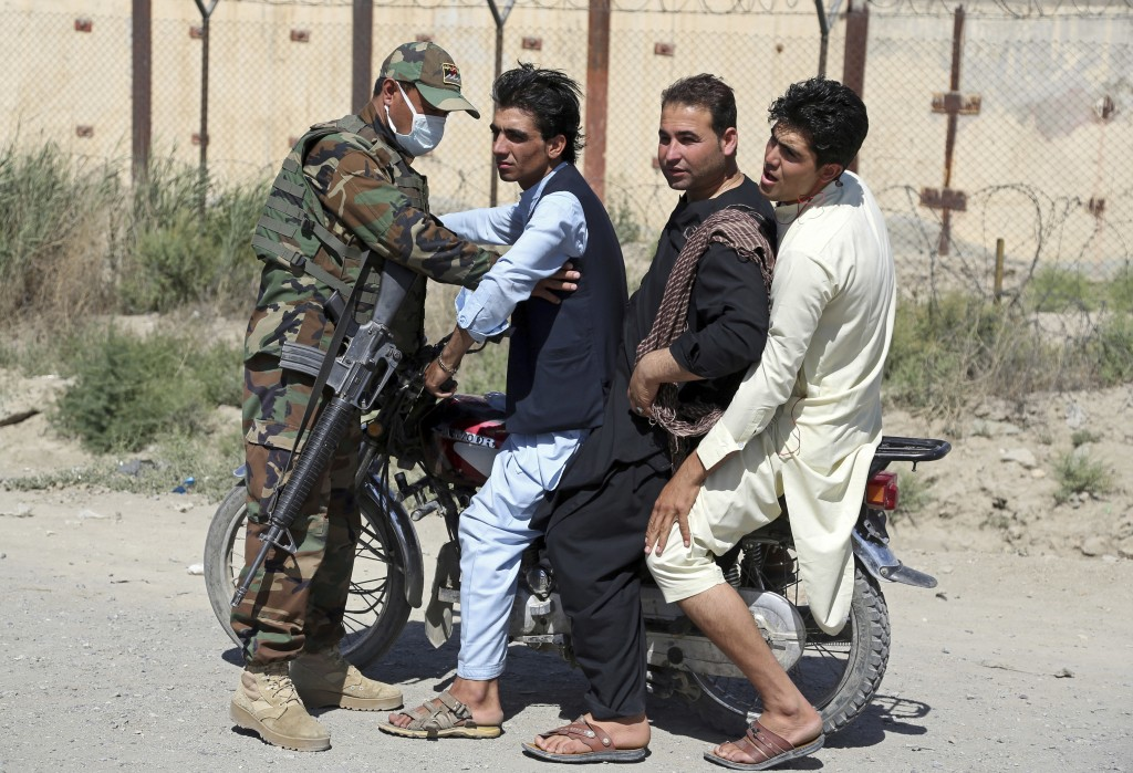 In this Tuesday, July 10, 2018, photo, an Afghan national army soldier searches a man at a checkpoint on the outskirts of Kabul, Afghanistan. Peace in...