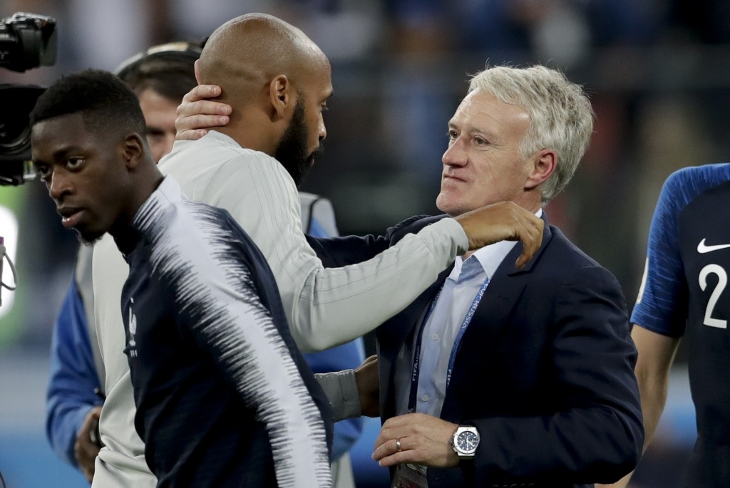 France head coach Didier Deschamps, right, greets Belgium assistant coach Thierry Henry at the end of the semifinal match between France and Belgium a