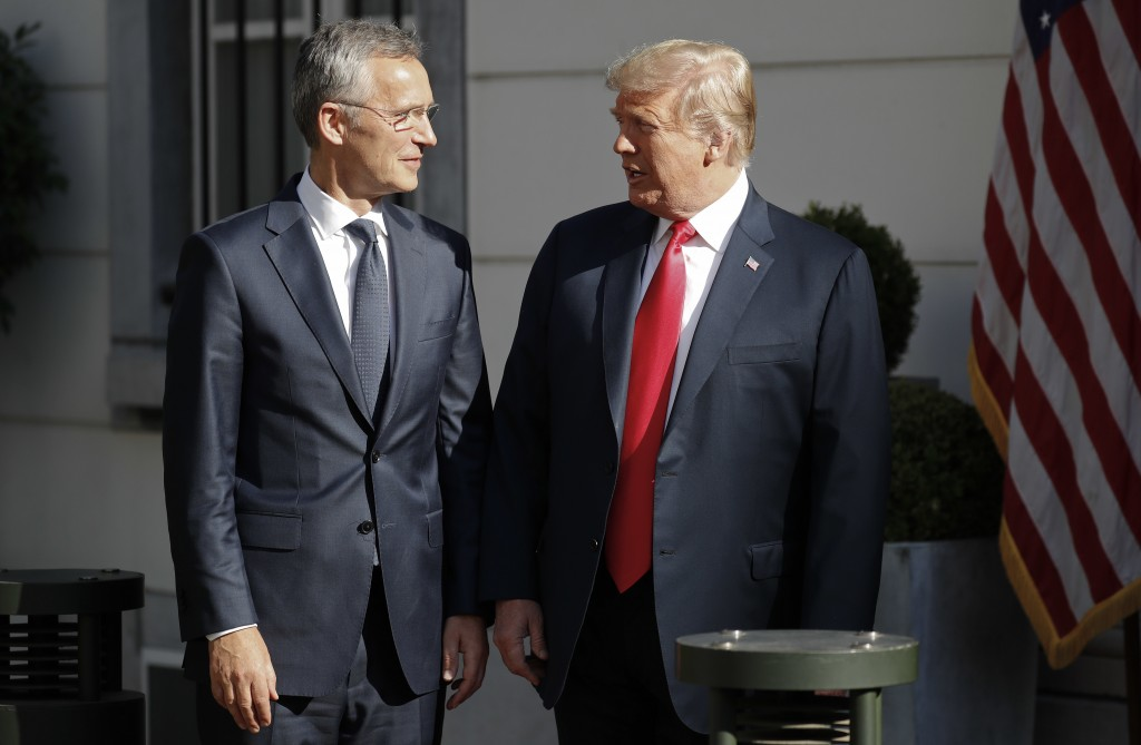 U.S. President Donald Trump, right, talks with NATO Secretary General Jens Stoltenberg, left, prior to their bilateral breakfast, Wednesday, July 11,