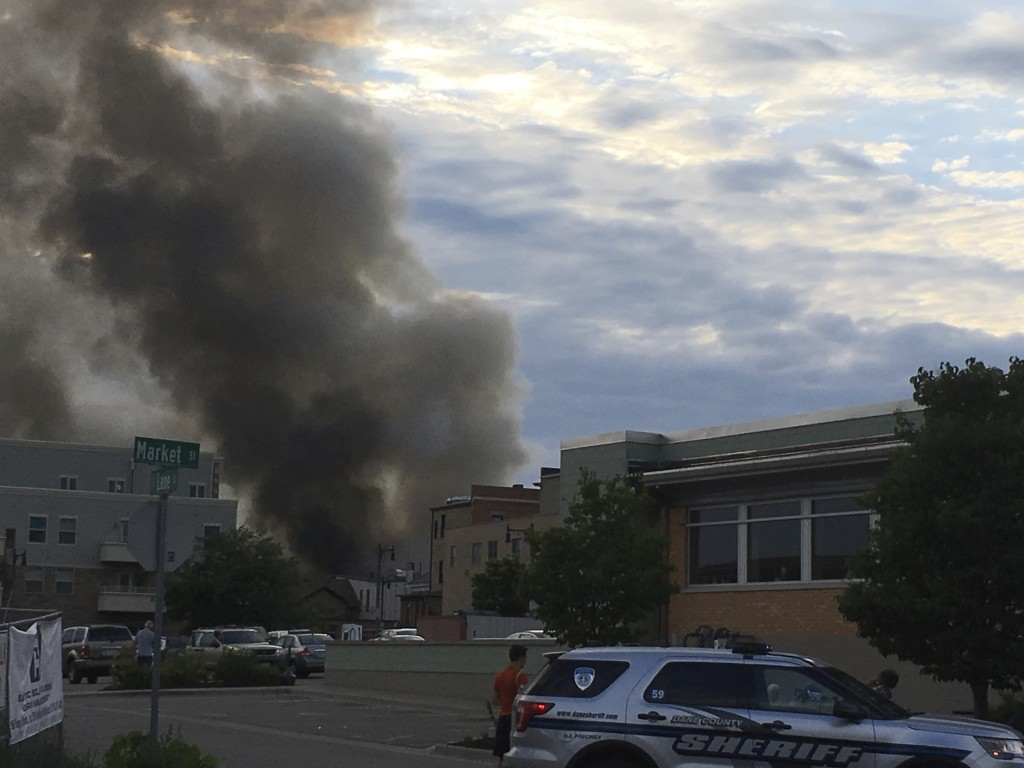 A major fire has broken out with a massive plume of smoke after a loud boom was heard in Sun Prairie, Wis., Tuesday, July 10, 2018. Firefighters from ...