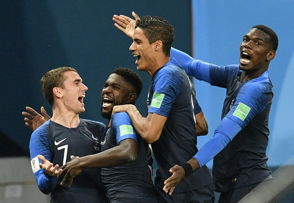 France's Samuel Umtiti, second from left, is congratulated by his teammates France's Antoine Griezmann, Raphael Varane and Paul Pogba, from left, afte
