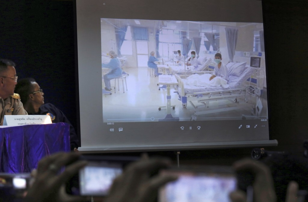 In this Wednesday, July 11, 2018, file photo, a projected image of the rescued boys in their hospital room is shown during a police press conference i