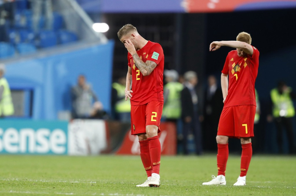 Belgium's Toby Alderweireld, left, and Belgium's Kevin De Bruyne stand on the pitch at the end of the semifinal match between France and Belgium at th